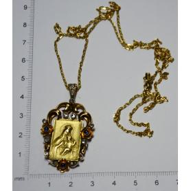 Médaille représentant la vierge à l'enfant en or