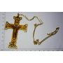 Large cross hanging on gold metal chain in gold.