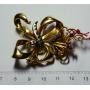 Broche en forme d'aiguille en or jaune