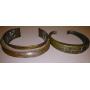 Lot de deux colliers en bronze doré. S. XX.