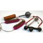 Tobilleras con cascabeles en tela rosa, sonajero, collar con grandes cascabeles, caja china y matraca tibetana.