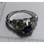 Ring, in white gold of law.
