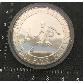 Pièce de monnaie en argent commémorant le XXV Jeux Olympiques.