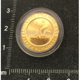 Pièce de monnaie à l'or fin pour commémorer le XXV Jeux Olympiques.